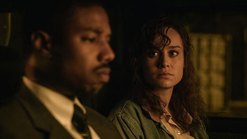 (L-r) MICHAEL B. JORDAN as Bryan Stevenson and BRIE LARSON as Eva Ansley in Warner Bros. Pictures' drama JUST MERCY.