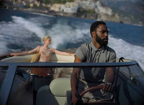 "ELIZABETH DEBICKI and JOHN DAVID WASHINGTON in Warner Bros. Pictures' action epic ""TENET."""